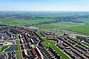 Nederland, Noord-Holland, Zaanstad, 20-04-2015; Noordpolder met de nieuwe woonwijk Saendelft, tussen Assendelft en Krommenie. De groenstrook heet Weideland, havengebied Amsterdam aan de horizon en Westzaan op het tweede plan.<br /> Newly developed residential area, Zaanstad. <br /> luchtfoto (toeslag op standard tarieven);<br /> aerial photo (additional fee required);<br /> copyright foto/photo Siebe Swart