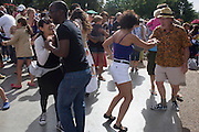 A diverse range of ages and ethnic backgrounds on the dancefloor as dancers enjoy an afternoon of a Latin music festival in south London.