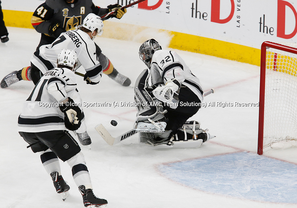 LAS VEGAS, NV - APRIL 11: Los Angeles Kings goaltender Jonathan Quick (32) blocks a puck during Game One of the Western Conference First Round of the 2018 NHL Stanley Cup Playoffs between the L.A. Kings and the Vegas Golden Knights Wednesday, April 11, 2018, at T-Mobile Arena in Las Vegas, Nevada. The Golden Knights won 1-0.  (Photo by: Marc Sanchez/Icon Sportswire)
