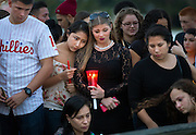 Friends, family and classmates gather at the Naples Pier for a candlelight vigil for slain 17-year-old Marcos Aleman on Thursday, Jan. 22, 2015, in Naples.  Seventeen-year-old  Meliton Cruz , of Immokalee, has been arrested in connection with a double shooting in Golden Gate Estates that left Aleman dead and a second teenager, Michael Stallone, hospitalized.