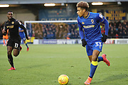 AFC Wimbledon striker Lyle Taylor (33) dribbling during the EFL Sky Bet League 1 match between AFC Wimbledon and Wigan Athletic at the Cherry Red Records Stadium, Kingston, England on 16 December 2017. Photo by Matthew Redman.