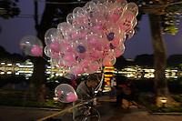 Selling ballons on Hanoi's Hoan Kiem Lake.