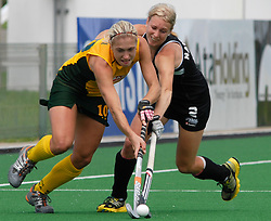 Cape Town 091015 Shelley Russell of South Africa meets New Zealand's Emily Taylor on the field during the BDO Champions Challenge match against New Zealand held at Hartleyvale Stadium. The match ended in a draw 3-3 and play again at 13:00 on the 17th October. Picture: Gareth Smit