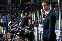 KELOWNA, CANADA - OCTOBER 23: Brad Ralph, head coach of the Kelowna Rockets stands on the bench against the Prince George Cougars on October 23, 2015 at Prospera Place in Kelowna, British Columbia, Canada.  (Photo by Marissa Baecker/Shoot the Breeze)  *** Local Caption *** Brad Ralph;