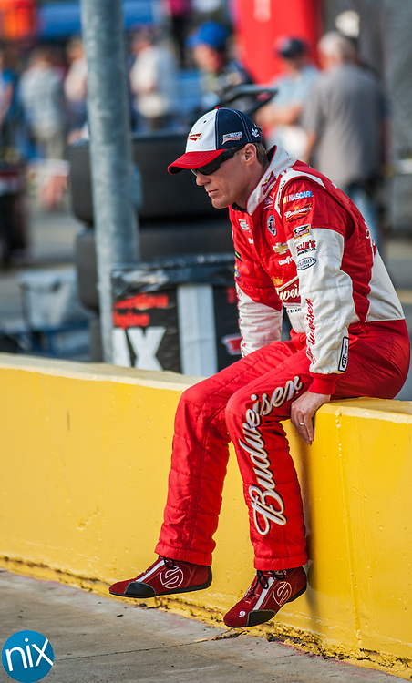 Kevin Harvick (4) waits along pit road prior to qualifying for the Coca-Cola 600 during Liftmaster Pole Night at Charlotte Motor Speedway on May 22, 2014.