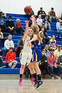 Milton's Kate Rowley (14) takes a three point shot during the girls basketball game between Lamoille and Milton at Milton High School on Friday night December 18, 2015 in Milton, (BRIAN JENKINS/for the FREE PRESS)
