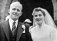 Jim Devlin, aka James Devlin, and his wife, Gertrude, pictured on their wedding day - both were shot dead by UVF gunmen in the laneway of their home at Edendork, near Coalisland, Co Tyrone, N Ireland, on 7th May 1974. Mrs Devlin had just collected her husband, a bar manager. Their 17 year old daughter survived the gun attack. Mr Devlin was a former GAA county footballer. Both Mr Devlin and his wife were members of the local SDLP branch. Some time later a 21 year old UDR soldier, who drove the gunmen, on becoming an evangelical Christian, later confessed to his part in the incident. 197405070262JD1.<br /> <br /> Copyright Image from Victor Patterson, 54 Dorchester Park, Belfast, UK, BT9 6RJ<br /> <br /> t1: +44 28 9066 1296 (from Rep of Ireland 048 9066 1296)<br /> t2: +44 28 9002 2446 (from Rep of Ireland 048 9002 2446)<br /> m: +44 7802 353836<br /> <br /> victorpattersonbelfast@gmail.com<br /> victorpatterson@me.com<br /> <br /> www.victorpatterson.com<br /> <br /> Please see my Terms and Conditions of Use at https://www.victorpatterson.com/page2<br /> It is IMPORTANT that you familiarise yourself with them.<br /> <br /> Images used on the Internet incur an additional cost and must be visibly watermarked i.e. © Victor Patterson within the body of the image and copyright metadata must not be deleted. Images used on the Internet have a size restriction of 4kbs and are chargeable at rates available at victorpatterson.com.<br /> <br /> This image is available only for the use of the download recipient i.e. television station, newspaper, magazine, book publisher, etc, and must not be passed on to any third party. It is also downloaded on condition that each and every usage is notified within 7 days to victorpatterson@me.com<br /> <br /> The right of Victor Patterson (or the named photographer) to be identified as the author is asserted in accordance with The Copyright Designs And Patents Act (1988). All moral rights are asserted.