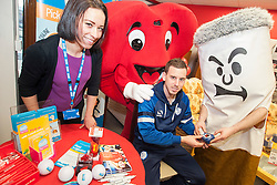 Big Cig and Hearty check Sheffield Wednesday footballer Marnick Vermijl Carbon Monoxide reading with the help of Rebekah Jepson the NHS Stop Smoking advisor at the Sheffield City Centre BHF Furniture & Electrical Store as part of Stop Smoking Sheffield No smoking Day Campaign<br /> <br /> 2 March 2015<br /> Image © Paul David Drabble <br /> www.pauldaviddrabble.co.uk
