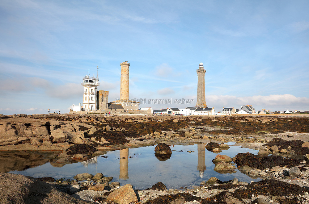 Left-right, the Semaphore, built 1862, the Vieille Tour or Old Tower, part of the Chapelle Saint-Pierre, where fires were lit to warn ships, the Phare de Penmarc'h, commissioned 1835 at 40m high, and the Phare d'Eckmuhl or Eckmuhl Lighthouse, also known as Point Penmarc'h Lighthouse or Saint-Pierre Lighthouse, built 1835 at 60m high, at Saint-Pierre on the Pointe de Penmarc'h, Finistere, Brittany, France. Three small fishing ports developed in this area, but despite the building of a breakwater, sea access remained perilous. Picture by Manuel Cohen