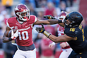 FAYETTEVILLE, AR - NOVEMBER 24:  Jordan Jones #10 of the Arkansas Razorbacks stiff arms Marcell Frazier #16 of the Missouri Tigers at Razorback Stadium on November 24, 2017 in Fayetteville, Arkansas.  The Tigers defeated the Razorbacks 48-45.  (Photo by Wesley Hitt/Getty Images) *** Local Caption *** Jordan Jones; Marcell Frazier