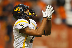 Oct 21, 2011; Syracuse NY, USA;  West Virginia Mountaineers wide receiver Brad Starks (2) prepares to field a kick off against the Syracuse Orange during the fourth quarter at the Carrier Dome.  Syracuse defeated West Virginia 49-23. Mandatory Credit: Jason O. Watson-US PRESSWIRE