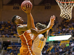 Feb 20, 2017; Morgantown, WV, USA; Texas Longhorns guard Kerwin Roach Jr. (12) shoots over West Virginia Mountaineers forward Nathan Adrian (11) during the first half at WVU Coliseum. Mandatory Credit: Ben Queen-USA TODAY Sports