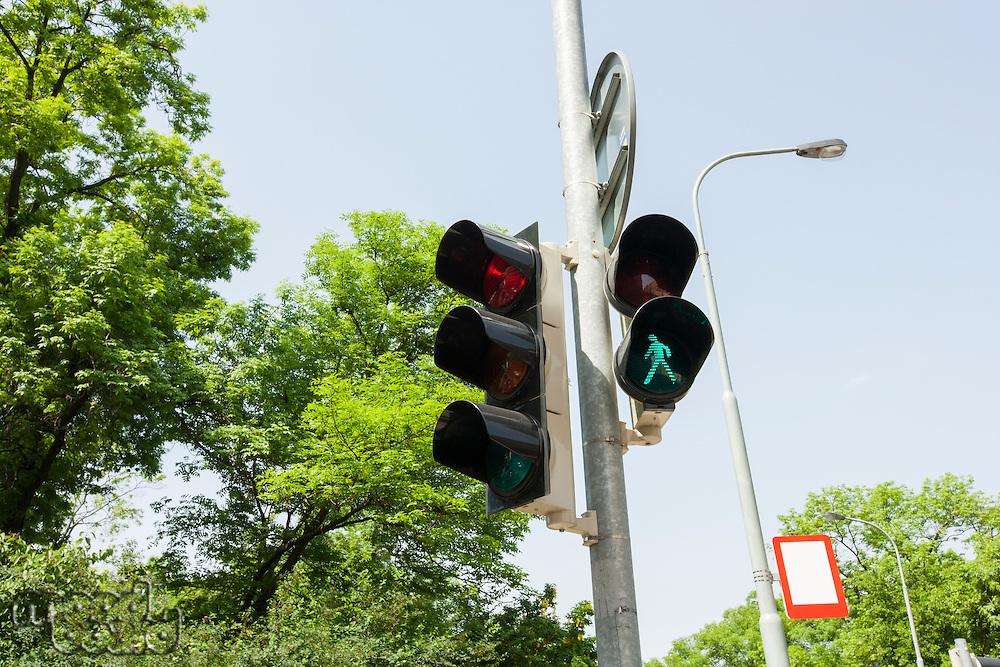 Traffic signal and street light against clear sky; Prague; Czech Republic