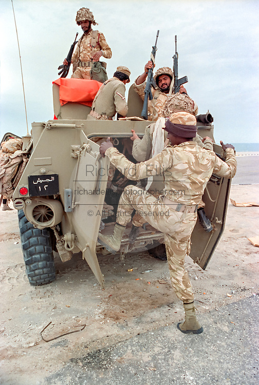Saudi Arabian soldiers load into an armored personnel carrier during clean up operations following the Battle of Khafji February 2, 1991 in Khafji City, Saudi Arabia. The Battle of Khafji was the first major ground engagement of the Gulf War.