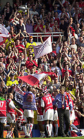 Foto: Peter Spurrier, Digitalsport<br /> NORWAY ONLY<br /> <br /> 15/05/2004  - 2003/04 Premiership Football - Arsenal v Leicester City<br /> <br /> The Trophy is shown to the crowd/supporters