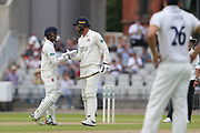 Lancashires Jordan Clark congratulated by Shivnarine Chanderpaul for his 50 during the Specsavers County Champ Div 1 match between Lancashire County Cricket Club and Essex County Cricket Club at the Emirates, Old Trafford, Manchester, United Kingdom on 9 June 2018. Picture by George Franks.