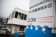 The sign shows the height of two tsunami which happened in 1896 and 1960. A fisherman tells that his ancestors were killed by the one in 1896 so they moved to higher spot. Because of that he was able to survive the tsunami in 2011.