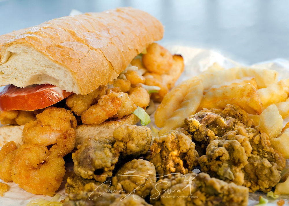 A shrimp po-boy, with fried oysters and french fries, is pictured at The Common Loon restaurant on Dauphin Island in Alabama Sept. 7, 2012. (Photo by Carmen K. Sisson/Cloudybright)