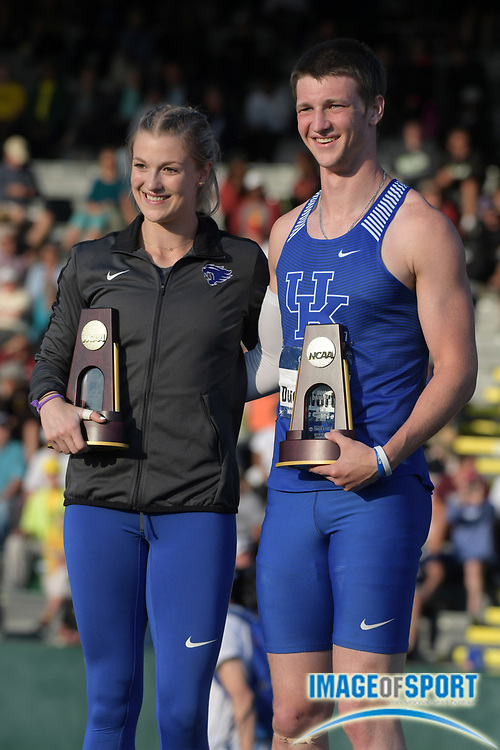 Jun 7, 2018; Eugene, OR, USA; Olivia Gruver (left) and Tim Duckworth of Kentucky pose after winning the women's pole vault and decathlon during the NCAA Track and Field championships at Hayward Field.