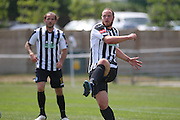 Peacehaven Ross Sutton clears the ball during the Pre-Season Friendly match between Peacehaven & Telscombe and Luton Town at the Peacehaven Football Club, Peacehaven, United Kingdom on 18 July 2015. Photo by Phil Duncan.