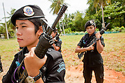 Sept. 29, 2009 -- BAAN TROKBON, THAILAND: Thai women Army Rangers drill with their rifles at the their base. The 39 women in the 44th Army Ranger Regiment are the only Thai women seeing front line active duty against Moslem insurgents in Thailand's deep south provinces of Pattani, Narathiwat and Yala. All of the other women serving in Thai security services are employed as office and clerical workers. The Ranger women are based at the Ranger camp in the Buddhist village of Baan Trokbon in Sai Buri district of Pattani province. The unit was formed in 2006 after Muslims complained about the way Thai soldiers, all men, treated Muslim women at roadblocks and during security sweeps. The women are frequently called upon to back up Thai regular army units when they are expected to encounter a large number of Muslim women. At least two of the women have been killed by Muslim insurgents. The unit has both Muslim and Buddhist members. Many of the women in the unit joined after either their fathers or husbands were killed by insurgents.    Photo by Jack Kurtz / ZUMA Press