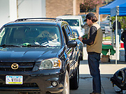 09 MAY 2020 - DES MOINES, IOWA: the Governor allowed farmers' markets across the state to reopen last weekend, but limited them to selling just food stuffs. They are not allowed to have entertainment or sell non-food items. Most farmers' markets in Iowa are taking a wait and see approach to reopening. The Downtown Farmers Market in Des Moines announced they won't reopen until July. Three vendors set up their own drive through farmers' market in the parking lot of Des Moines theatre Saturday. Hundreds of people got in line to buy fresh produce and artisan cheese. More than 11,670 people have tested positive for COVID-19 in Iowa and more than 250 have died from the disease.          PHOTO BY JACK KURTZ