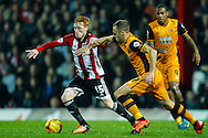 Ryan Woods of Brentford and David Meyler of Hull City during the Sky Bet Championship match between Brentford and Hull City at Griffin Park, London<br /> Picture by Mark D Fuller/Focus Images Ltd +44 7774 216216<br /> 03/11/2015