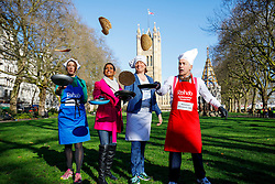 © Licensed to London News Pictures. 28/02/2017. London, UK. BARONESS BERTIN, NAGA MUNCHETTY, TRACEY CROUCH MP and ALASTAIR STEWARD OBE practise their pancake flips before racing against MPs, Lords and members of media at of the annual Rehab Parliamentary Pancake Race outside the Parliament on Shrove Tuesday, 28 February 2017. Photo credit: Tolga Akmen/LNP