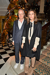 HANS-ULRICH OBRIST and DASHA ABRAMOVICH at a party to celebrate theunveiling of the Claridge's Christmas Tree designed by Christopher Bailey for Burberryheld at Claridge's, Brook Street, London on 18th November 2015.