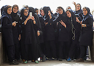Iran, Province Of Isfahan, Kashan, Iranian students taking pictures with mobile phones. In Iran, accessories have become a big way to exhibit some style. The iPhone is in vogue.