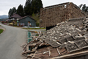An earthquake destroyed building in the abandoned village of Tsushima in rural Fukushima near the exclusion zone, Fukushima Japan. Wednesday May 5th 2011. After the explosions at the Daichi nuclear plant caused by the March 11th 2011 earthquake and tsunami. High levels of radioactive contamination in this village have made it uninhabitable.