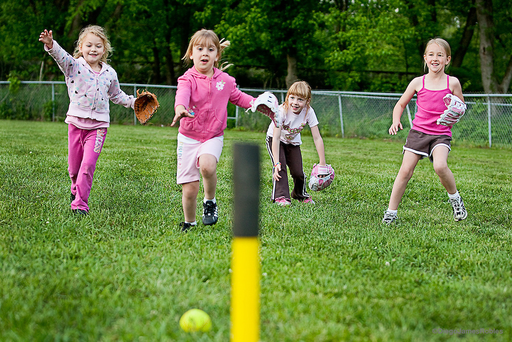 From right, Heidi Jo, and her t-ball teammates chase a loose ball during fielding practice in Logan, on Monday afternoon, May 11. Like most child beauty queens, Heidi is involved in numerous extracurricular activities.