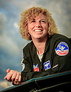U.S. Air Force Colonel Jill Long has been a aerial refuling tanker pilot, flown an A-10 Warthog on over 50 combat missions in Afghanistan, and has been a squadron commander in Germany.  In her spare tiime, she flies a Pitts S2B doing aerobatic routines at airshows across the country.  Photographed for Women In Aviation during Airventure 2009, in Oshkosh, Wisconsin.  Created by aviation photographer John Slemp of Aerographs Aviation Photography. Clients include Goodyear Aviation Tires, Phillips 66 Aviation Fuels, Smithsonian Air & Space magazine, and The Lindbergh Foundation.  Specialising in high end commercial aviation photography and the supply of aviation stock photography for commercial and marketing use.