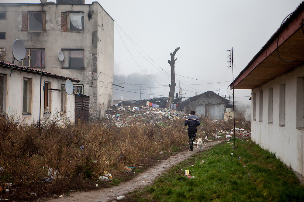"A man with his dog at the Roma settlement ""Budulovskej Street"" in Moldava nad Bodvou, Eastern Slovakia, about 30 km from Kosice."