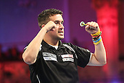 Jamie Lewis celebrates victory over Justin Pipe during the First Round of the BetVictor World Matchplay Darts at the Empress Ballroom, Blackpool, United Kingdom on 19 July 2015. Photo by Shane Healey.