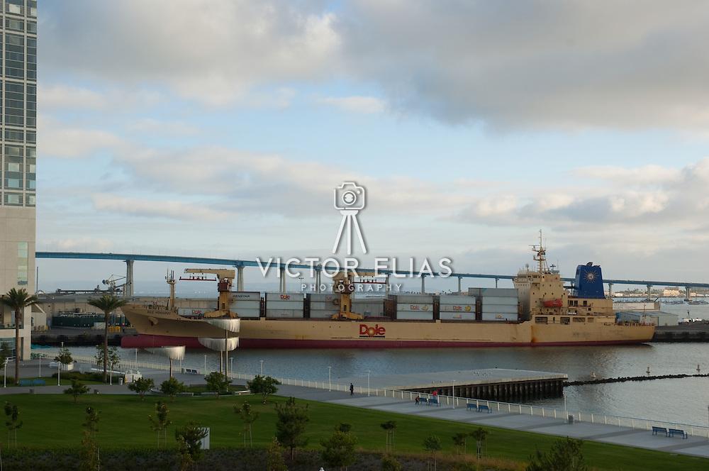 Cargo ship on dock at San Diego harbor.
