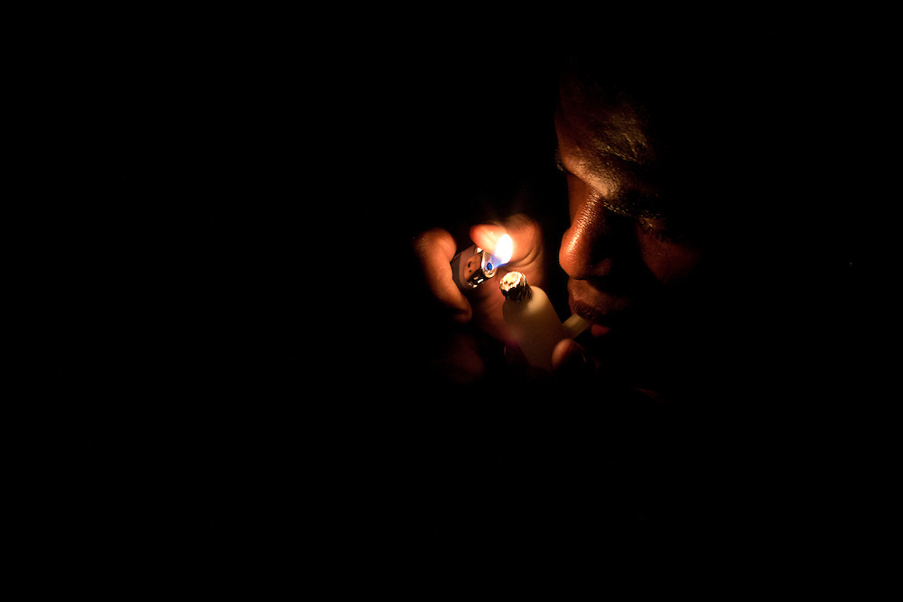 In this photo taken Saturday, Dec. 8, 2012, a man smokes crack at a slum in western Rio de Janeiro, Brazil.  <br /> <br />  The South American country began experiencing a public health emergency in recent years as demand for crack boomed and open-air &quot;cracolandias,&quot; or crack lands, popped up in the sprawling urban centers of Rio and Sao Paulo, with hundreds of users gathering to smoke the drug. The federal government announced in early 2012 that more than $2 billion would be spent to fight the epidemic, with the money spent to train local health care workers, purchase thousands of hospital and shelter beds for emergency treatment, and create transitional centers for recovering users.
