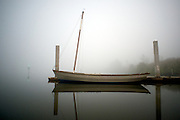 A sailboat rests at pier just off of Sunset Island on the Barron River on a foggy morning in the Everglades.