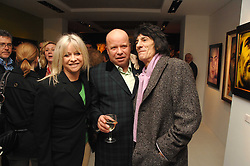 Left to right, JO WOOD, PAUL KARSLAKE and RONNIE WOOD at an exhibition of artist Paul Karslake's work entitled Ideas & Idols, held at Scream, 34 Bruton Street, London W1 on 21st February 2008.<br />