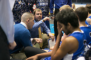 Geneseo Head Coach Brian Paganin speaks to his team during the Class C2 Sectional Championship game against Caledonia-Mumford at Blue Cross Arena on Saturday, March 7, 2015.