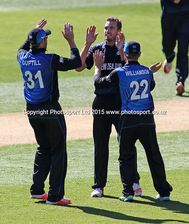 Martin Guptill & Kane Williamson celebrate a 7th wicket to Tim Southee during the ICC Cricket World Cup match between New Zealand and England at Wellington Regional Stadium, New Zealand. Friday 20th February 2015. Photo.: Grant Down / www.photosport.co.nz
