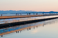 The Breakwater at Ogden Point is a popular walking spot on a warm evening in Victoria, BC