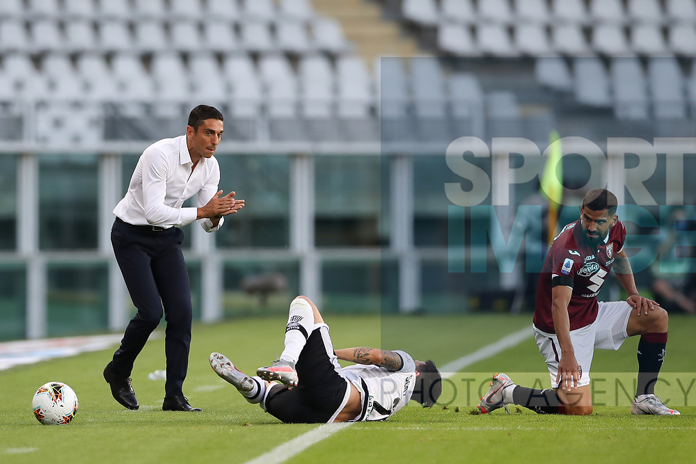 Torino FC's Italian Head coach Moreno Longo applauds as Parma Calcio's Italian midfielder Matteo Scozzarella tumbles in front of him following a late challenge by Torino FC's Venezuelan midfielder Tomas Rincon during the Serie A match at Stadio Grande Torino, Turin. Picture date: 20th June 2020. Picture credit should read: Jonathan Moscrop/Sportimage