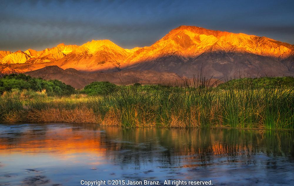 Sunrise light on the Sierra Nevada above the Owens River near Bishop, California.
