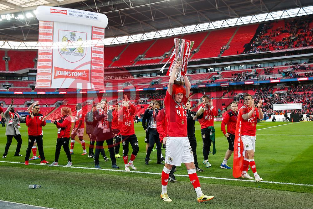 Luke Ayling lift up the Football League Trophy after Bristol City win the match 2-0 - Photo mandatory by-line: Rogan Thomson/JMP - 07966 386802 - 22/03/2015 - SPORT - FOOTBALL - London, England - Wembley Stadium - Bristol City v Walsall - Johnstone's Paint Trophy Final.