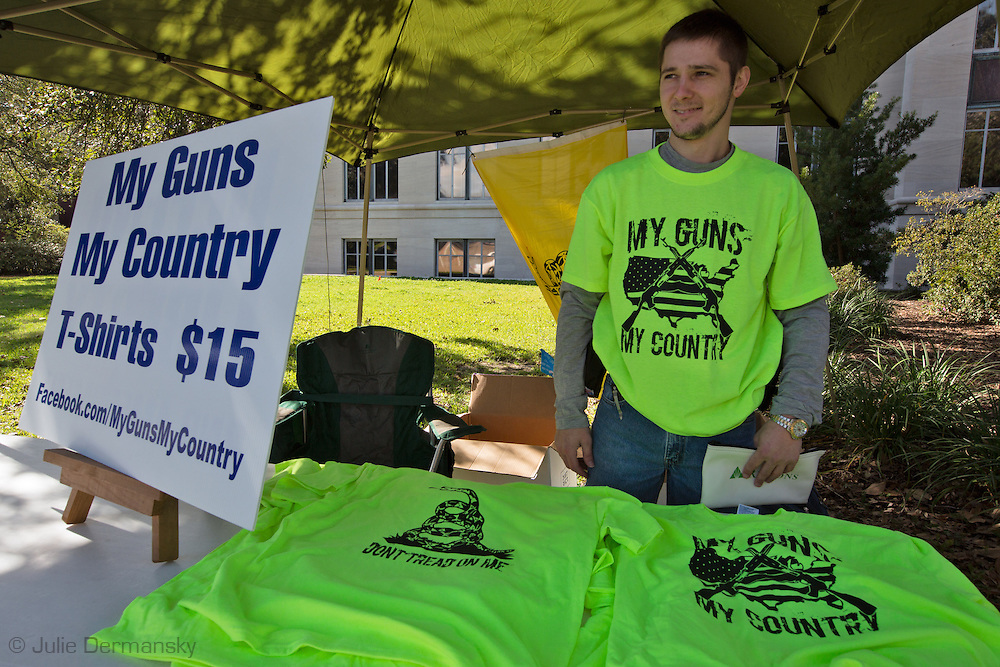 """January 18, Baton Rouge , Man selling pro-gun t-shirts at a pro-gun rally organized by """"Guns across America"""" on """"Gun Appreciation Day"""". After the massacre at  a school in Sandy Hook, Connecticut , the debate over gun control in America became a key political issue."""