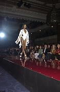 Naomi Campbell. Julian Macdonald  fashion show, Le Meridien Grosvenor House. After party, Il Bottaccio, Grosvenor Place. London. 14 September 2002. © Copyright Photograph by Dafydd Jones 66 Stockwell Park Rd. London SW9 0DA Tel 020 7733 0108 www.dafjones.com