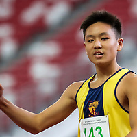 Mark Lee (#143) of Anglo-Chinese School (Independent) celebrates after winning the C Division boys' 100m final. (Photo © Lim Yong Teck/Red Sports)