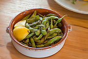 Wood fired edamame at Oven and Tap on Friday, February 19, 2016, in Bentonville, Arkansas. Beth Hall for the New York Times