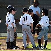A coach talks to his players during the Norwalk Little League baseball competition at Broad River Fields,  Norwalk, Connecticut. USA. Photo Tim Clayton